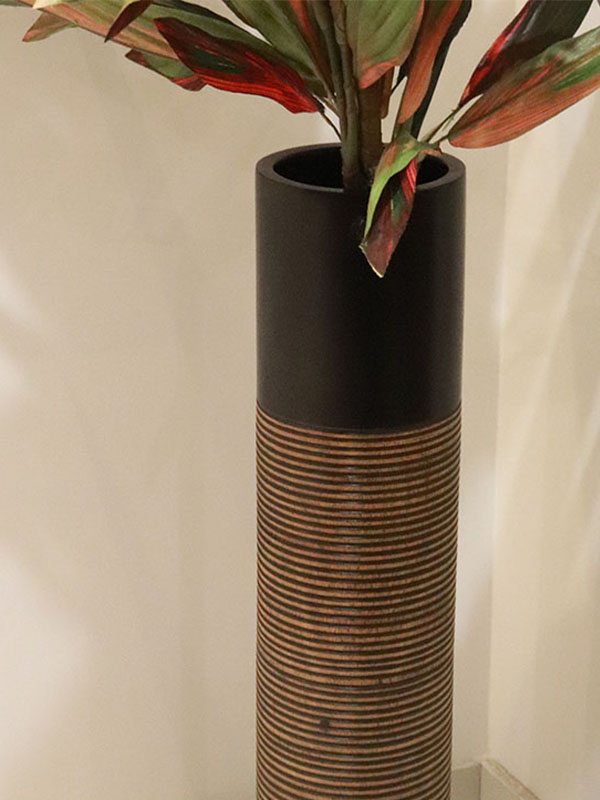 Wooden vase in brown color